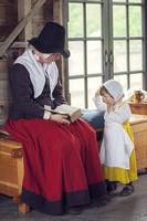 Tudor mother reads to child