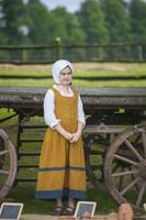 Tudor girl in front of cart