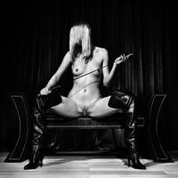 Kinky fetish image with a nude woman in black and