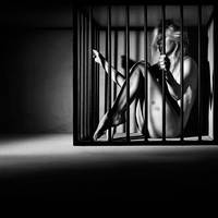 Nude Woman locked in a steel cage