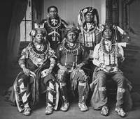 Oto delegation of five wearing claw necklaces and