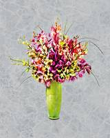 Assorted Crayon Colored Orchids in Chartreuse Vase