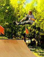 AA Flying High on Skateboard Ramp at the Park