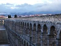 Aqueduct Of Segovia With Mountains And Stairs