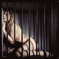 Nude Woman in a cage. Image in vintage movie poste
