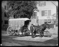 Iceman and helper with Jamaica Pond Ice Co. wagon,