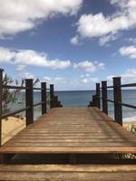 Wooden Boardwalk Leading to Sea