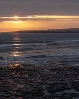 Sunset with a surfer at Lahinch Beach