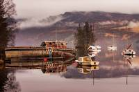 Misty morning reflections of Loch Ness