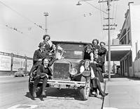 Group of young women and Model T Ford car, 1950 Ne