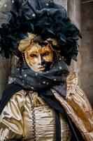 Venetian mask costume black gold looking away