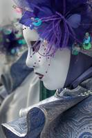 Venetian mask costume purple and white close-up