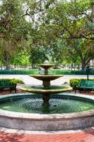 three tier park fountain with green water