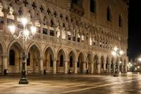 Doge Palace Venice at night with lamp posts