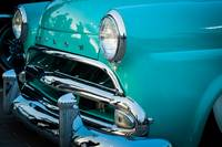 Chrome bumper and grill of classic car
