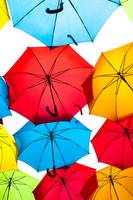 Many colorful umbrellas against the sky