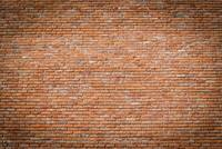 Red brick wall texture with vignetted corners