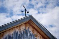 Weathered barn and weather vane.