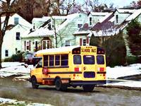 School Bus Driving Home in Winter