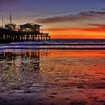 """Santa Monica Pier Winter Sunset Over Low Tide"" by natesiggard"