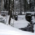"""antique granite dam in winter"" by bigfigyogi"