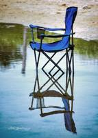 Blue Beach Chair In Water Woodneck Beach