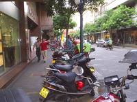 Motorcycle Taxis Parked On Main Street In Xiaolan
