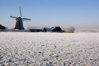 Winter landscape with windmill