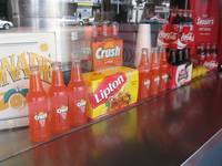 Orange crush bottles at counter
