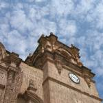 """Clouds over Puno Cathedral"" by joanndeasy"