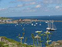 Alderney Harbour and breakwater with Sailing ship