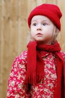 Young Girl in Red Coat