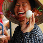 """Smiling Woman with Egg"" by jcarillet"