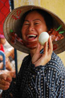 Smiling Woman with Egg
