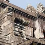 """Monk exiting through a window of Angkor Wat, Cambo"" by KeithKelly"