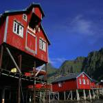 """Red robuer in the town of A, Lofoten, Norway"" by RaphaelBickPhotography"