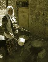 Turkish Woman With A Cookpot