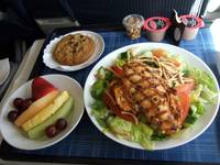 UA566 SNA-ORD F-CL Meal