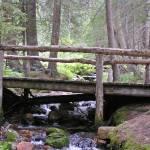 """Wooden Bridge on Creek"" by MarksClickArt"