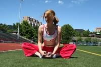 Woman stretching on field
