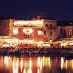 """Crete. Rethymnon harbor at night"" by SteveOutram"