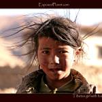 """Tibetan girl with dirty hair blowing"" by ExposedPlanet"