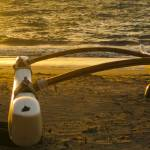 """outrigger canoe at sunset 1"" by sant"