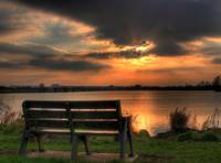 Bench at lake Sunset