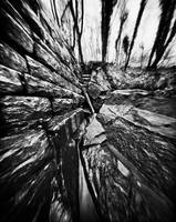 Wet Granite Through a Pinhole