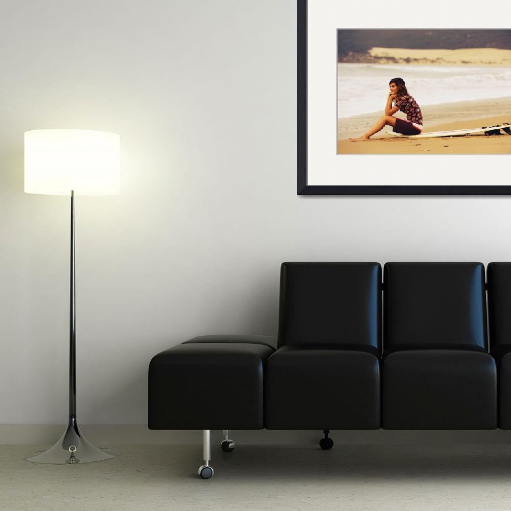 """Young Woman Sitting On Her Surf Board On The Beach&quot  by DesignPics"