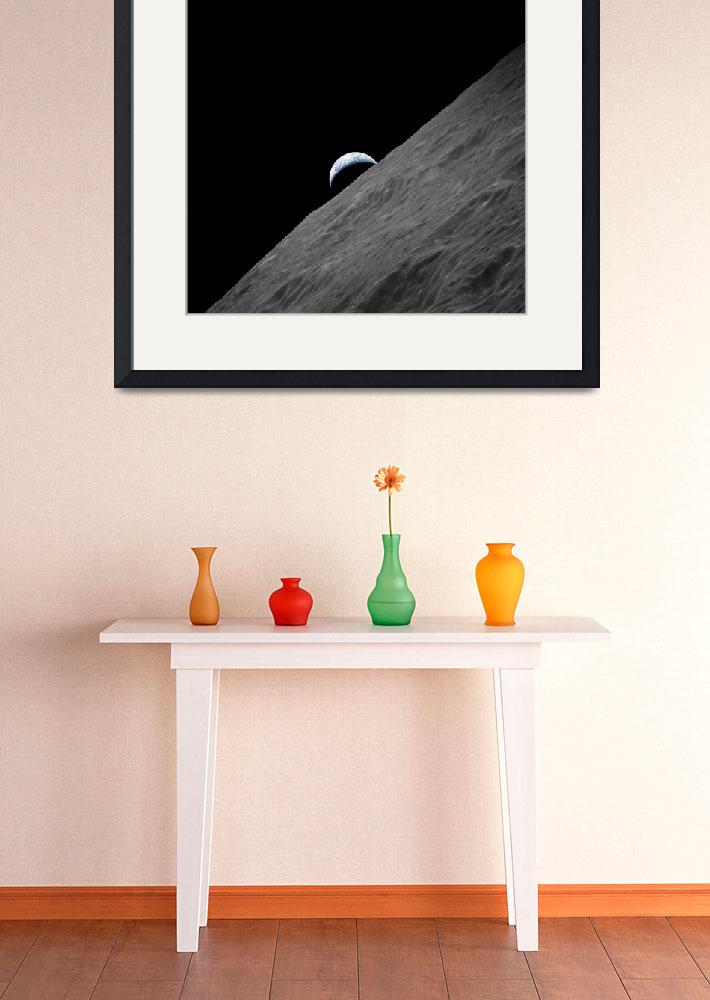 """The crescent Earth rises above the lunar horizon&quot  by stocktrekimages"
