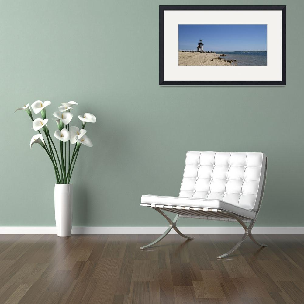 """Beach with a lighthouse in the background&quot  by Panoramic_Images"