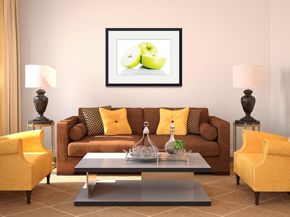 """Green apples divided on two half. Isolated on whit&quot  by Piotr_Marcinski"