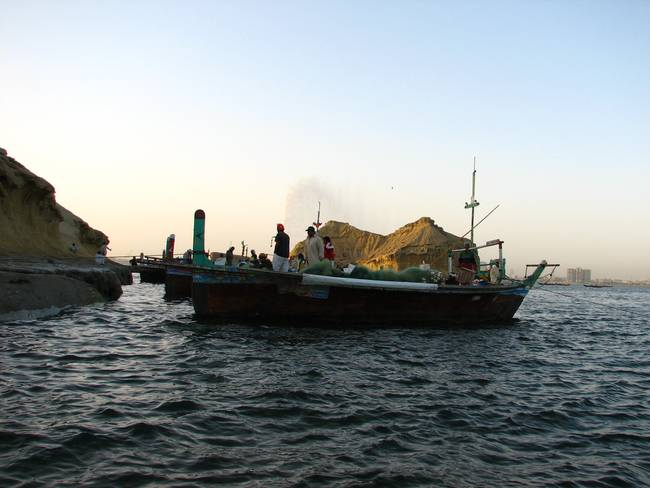 Traditional Fishing Boats alongside oyster rocks k